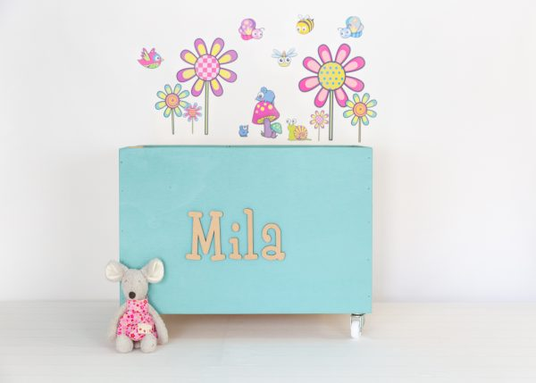 Flowers and bugs wall decals with teal large toybox
