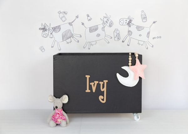 Monochrome cows with black large toybox on wheels